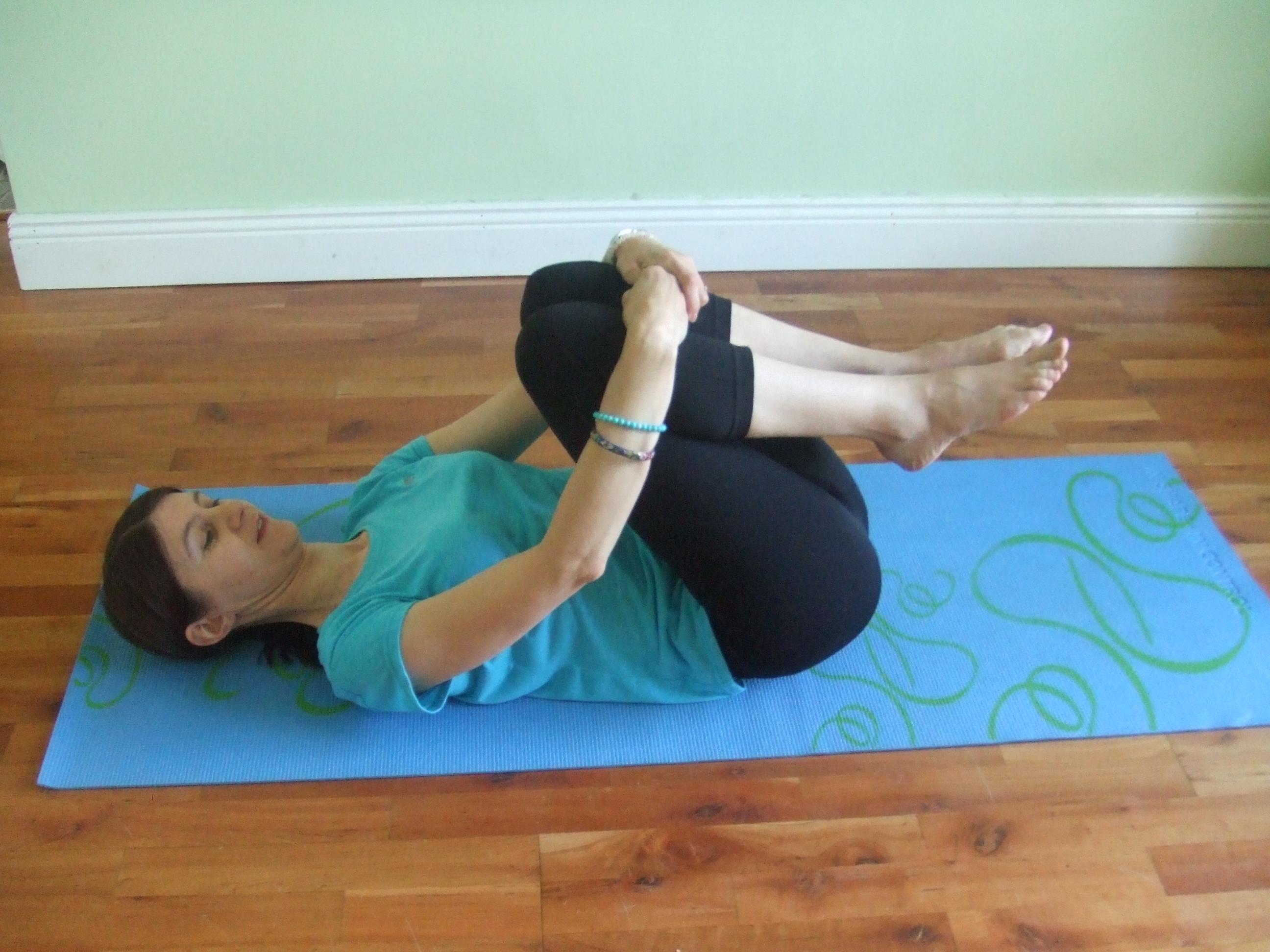 laying on back extend lower back